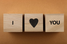 Wooden Cubes With I LOVE YOU Words Over Brown