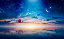 Crescent And Hot Air Balloon Rising Above Serene Sea In Sunset Glowing Sky