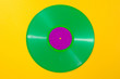 Green vinyl record on yellow background - Retro concept