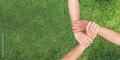 Fototapeta Authentic triangle partners hands together concept