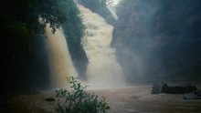 Dramatic Tirathgarh Water Falls Cascading Over A Rocky Cliff Face In A Lush Forest Creating A Moody Mist Environment