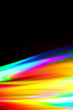 canvas print picture - Beams of light refracting and creating a rainbow spectrum of colours against a black background