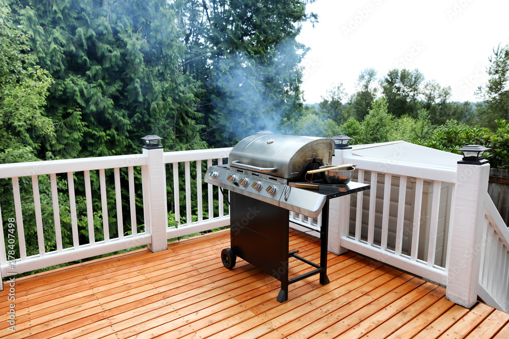 Fototapety, obrazy: Barbecue grill cooking with visual smoke in open outdoor deck during summer day