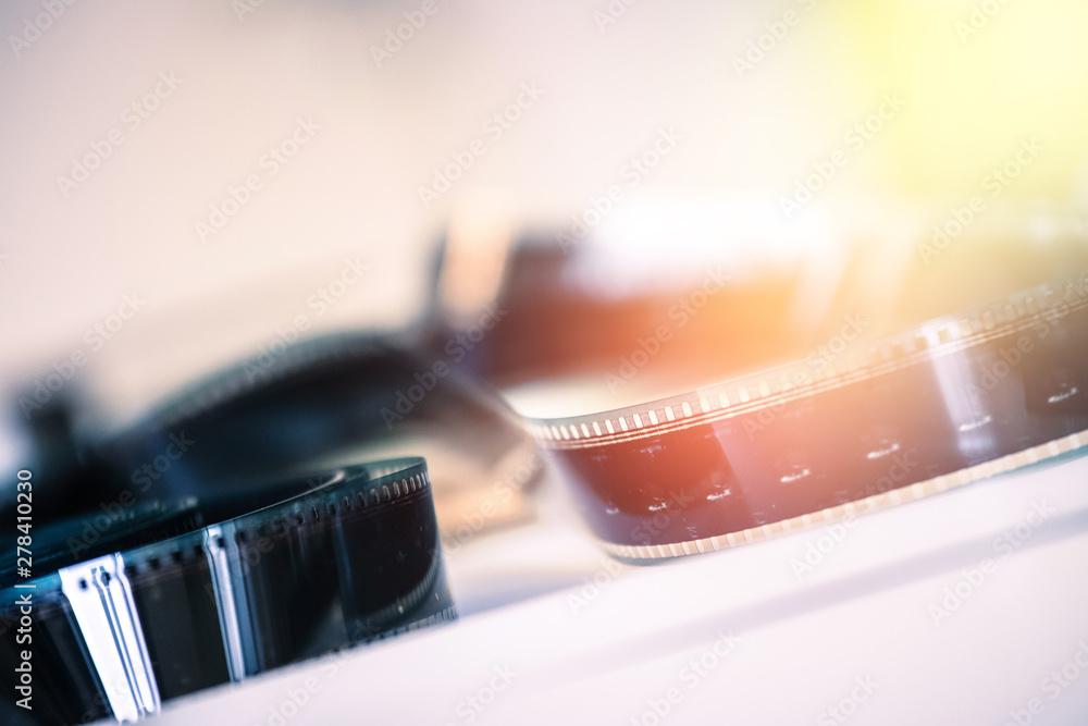 Fototapety, obrazy: Cinema film reel or filmstrip, close up picture