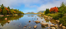 View Of The Clear Water, Stones And Fall Foliage Of Jordan Pond In Acadia National Park