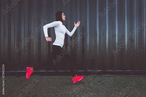 Arabic woman runner, making some urban running