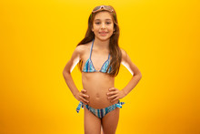 Child Wearing Bikini On Yellow...