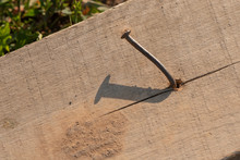 Rusty Nail Sticking Out Of An ...