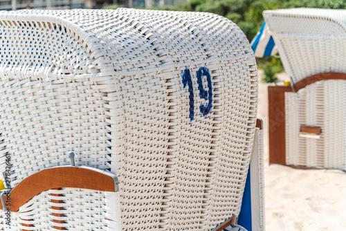 Fotobehang Noordzee Beach chair on sand beach, 19