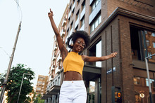 Joyful Afro-american Lady With Dancing In The City