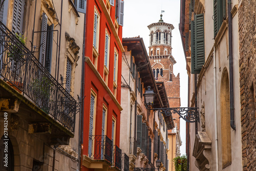 Fototapety, obrazy: Verona, Italy, on April 24, 2019. the picturesque narrow street with a traditional architectural complex in the old city.