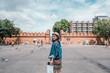 Young beautiful women traveler walking in the city