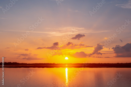 Montage in der Fensternische Lavendel Sunset reflection lagoon. beautiful sunset behind the clouds and blue sky above the over lagoon landscape background. dramatic sky with cloud at sunset