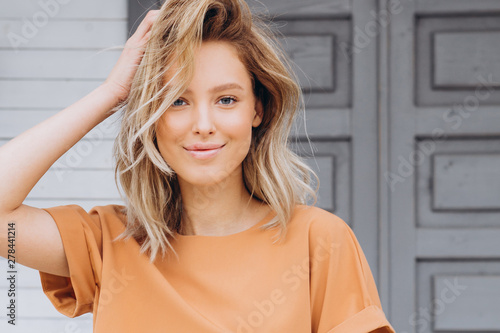 Fototapeta  Portrait of an attractive blonde woman poses for the advertisement of a women's