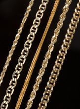 Five Gold Chain Necklaces Clos...