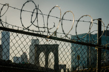 Fence And Barbed Wire In New York