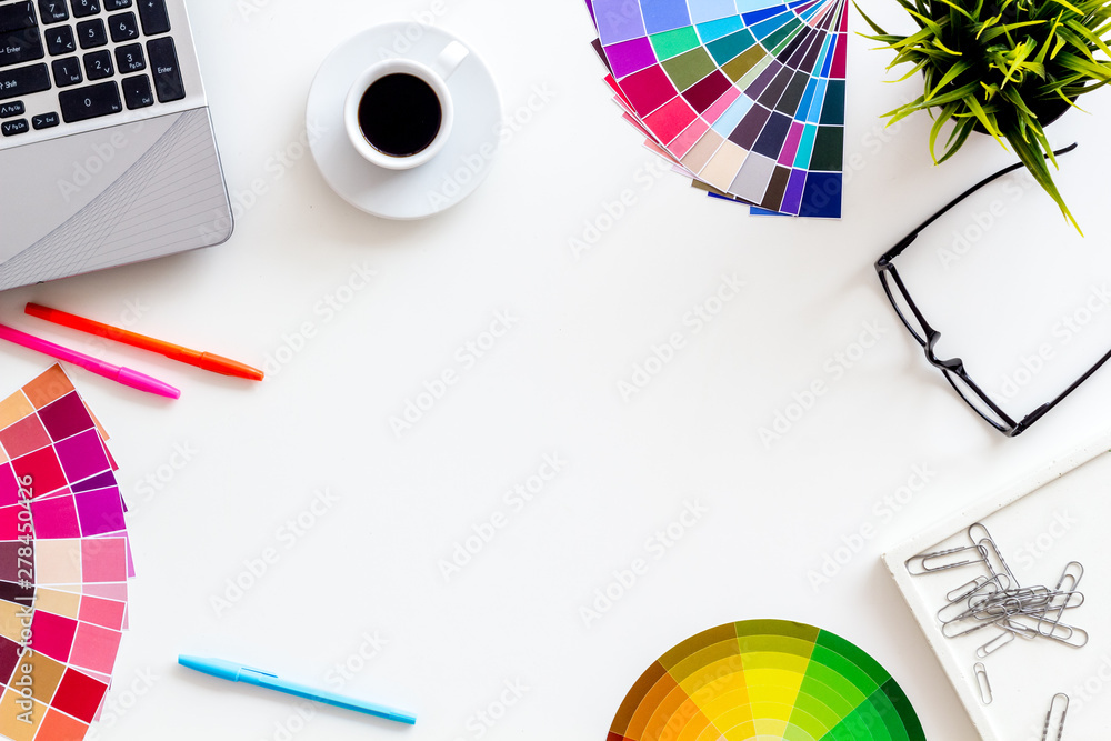 Fototapeta Work space of designer with instruments, pallet, laptop, glasses and coffee white background top view space for text