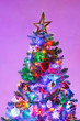 canvas print picture Christmas tree with multicolor led lights and purple background