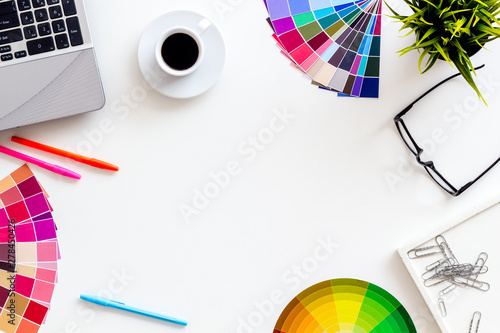 Work space of designer with instruments, pallet, laptop, glasses and coffee white background top view space for text