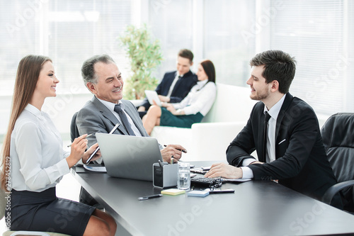 client talking with the staff at the Desk in the office