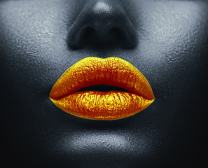 Creative colorful makeup. Bodyart, lipgloss on sexy lips, girl's mouth. Golde...