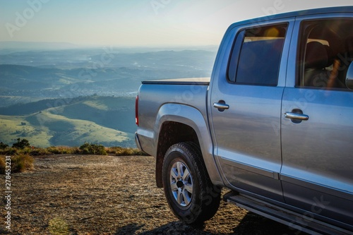 Obraz gray car on the mountain and at sunset - fototapety do salonu