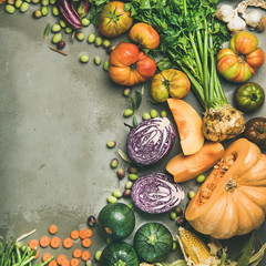 Healthy vegetarian seasonal Fall food cooking background. Flat-lay of Autumn vegetables and herb over grey concrete background, top view, copy space, square crop. Clean eating, alkaline diet food