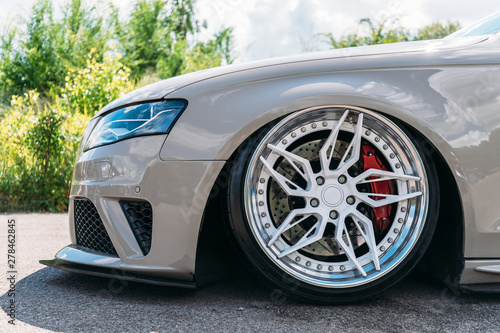 Fotografía  Lowrider custom tuned sport car wheel with small rubber tyre and large disk