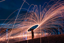 Steel Wool Spinning In The Evening At Water's Edge