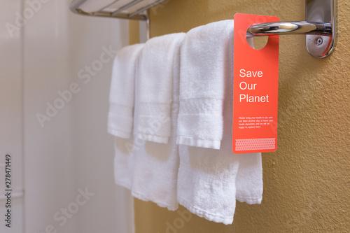 Save water sign label on hotel encourage guest reuse bath towel Fototapeta