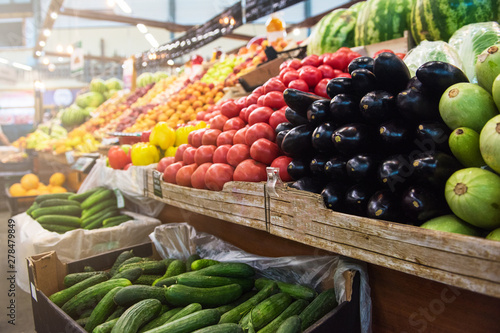 Fototapeta Vegetable farmer market counter: colorful various fresh organic healthy vegetables at grocery store