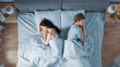 canvas print picture - Quarrelling Young Couple in the Bed, Young People Lying Turned Away From Each other and Lay on Their Sides Holding Grudges and Being Offended