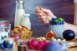 canvas print picture - Closeup female hands are preparing organic yogurt with chia for good digestion, functioning of gastrointestinal tract. Summer berries, nuts, fruits, dairy products on table. Healthy food concept.