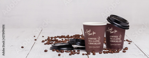 Fotobehang Cafe Paper cup of coffee and coffee beans on white wooden background