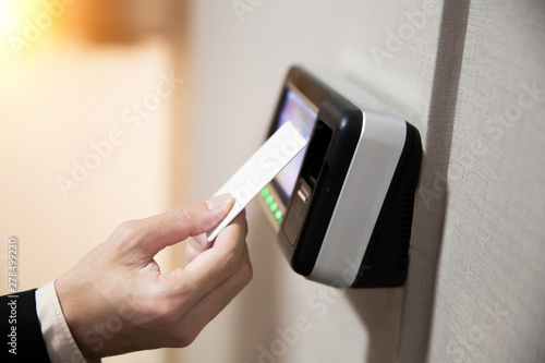 Photo Close-up Of Hand Businessman Using Keycard To Open Door.
