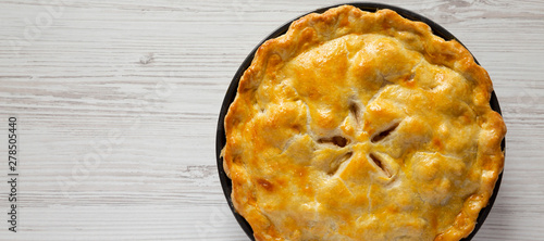 Homemade apple pie on a white wooden surface, top view Canvas Print