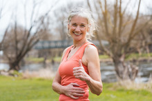 Senior Woman Giving Thumbs-up For Sport