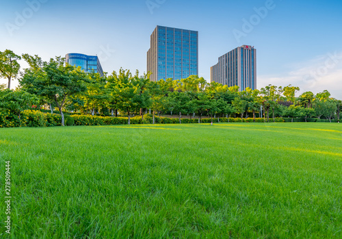 Foto auf AluDibond Grun Afternoon Lawn Green space and business building, Daning Tulip Park, Shanghai, China