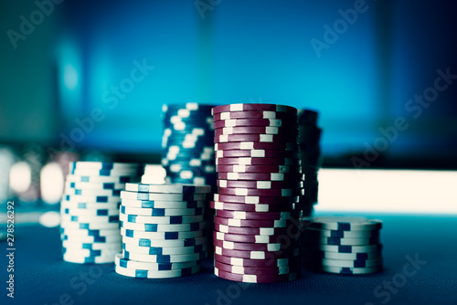 Photo  Piles of chips on the poker table