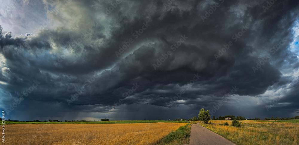Fototapeta Storm clouds with shelf cloud and intense rain