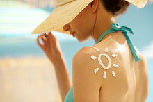 Woman Tanning At The Beach Wit...