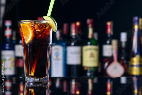 classic cocktail cuba libre with ice and close-up in a cuban bar Canvas Print