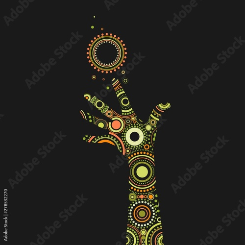Photo Fantasy painted hand with bright ethnic ornament of circles and dots