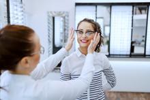 Female Optician Putting Eyegla...