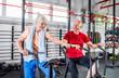 Senior couple biking at the gym