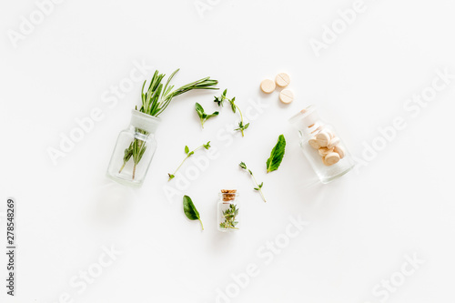 Healing herbs and pills for medicine on white background top view Canvas Print