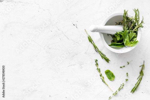 Obraz Alternative medicine with medicinal herbs on white marble background top view mock up - fototapety do salonu