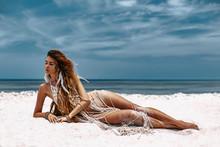Beautiful Young Woman In Boho Style Bikini Lying On Sand At The Beach