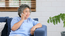 Senior Asian Woman Talking Pho...