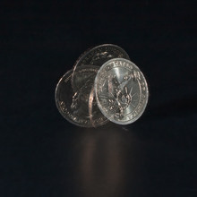 Spinning Coin In Stroboscopic Light On A Dark Background, Close Up. One Dollar